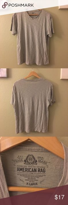 American Rag v neck top This is an American rag v neck t shirt for men size X large. It is in good condition no stains and no tares.   #americanrag #anericanragtshirt #shirt #tshirt American Rag Shirts Tees - Short Sleeve
