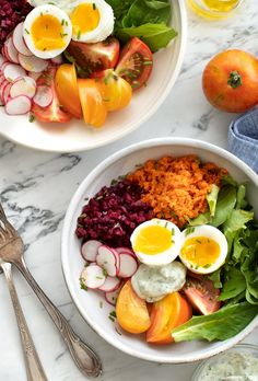 Farmers Market Breakfast Bowls - the ultimate savory summer breakfast with riced & spiced carrots and beets, greens, radishes, tomatoes, a soft-boiled egg, and herbed yogurt sauce. / loveandlemons.com #healthybreakfast #recipe
