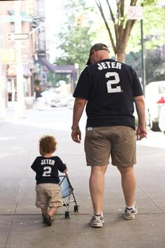 Not sure what's in the stroller, but I hope it has a Jeter jersey.