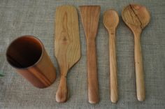 Cherry hand carved spoon and spatula set with vase