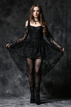 Ghost Gothic Dress by Dark in Love features black lace buttons down the centre front and long lace flared sleeves. There's black cord lacing over the open shoulders and at the centre back.