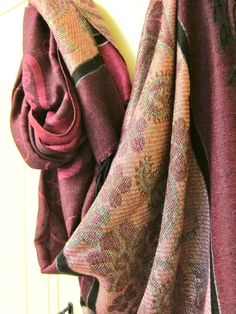 Elegant Handwoven Scarf in maroon and pink shimmer with flower embroidery.  Cozy and chic, this scarf will brighten up your outfit and keep you com...