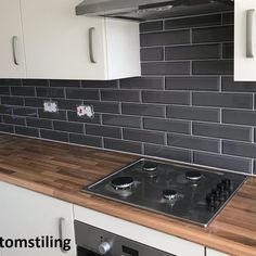 Marylebone Dark Grey So I really like this! The brick tiles and Grey tone is nice. Also think it's smart with the wood worktop finish, unit doors; unsure if that is cream or not which I'm unsure about. Grey Kitchen Wall Tiles, Wood Worktop Kitchen, Dark Gray Backsplash, Metro Tiles Kitchen, Kitchen Splashback Tiles, Dark Grey Kitchen, Dark Grey Tiles, Cream And Wood Kitchen, Brick Bathroom