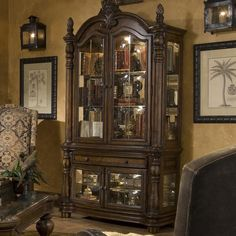 Vizcaya Curio w/ Glass Door by Michael Amini-This grand curio cabinet with tons of storage inside four glass doors offers a #traditional way to accent your home.