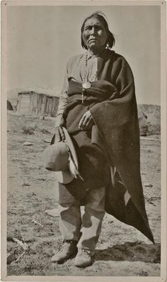 John Rope of Bylas posing outside. He wears a cotton shirt, a trade blanket, and a beaded necklace with a silver medallion.San Carlos Apache, b. ca, 1863 Native American Photos, American Indian Art, Native American History, Native American Indians, Plains Indians, Arizona, Native Indian, Before Us, First Nations
