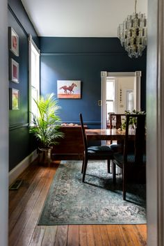 The dining room is coated in Farrow and Ball Hague Blue. The chairs are vintage and were reupholstered. The chandelier was found on Craigslist.