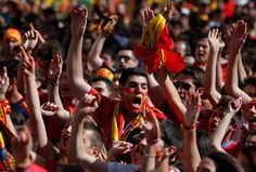 Spain's fans watch the Euro 2012 soccer championship Group C match between Spain and Italy in a fan park in Madrid, Spain on June 10. (Andres Kudacki/Associated Press)