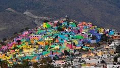 Hidalgo, Mexico Houses on a hill are painted with vivid colours