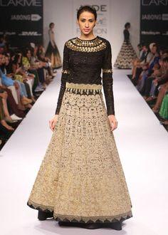 Embroidered lehenga accented by gold embellishment paired with black lace body-suit #Lakmefashionweek #winterfestive #JADE #JadebyMK #JadeatLFW