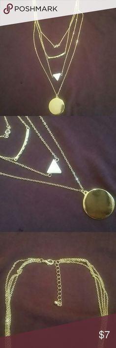 Layered gold necklace Top first layer is a small circle crystal. The second is a slightly hammered gold bar. The third layer is a white shell triangle. And the last fourth layer is a gold circle. I was going to get my initials monogramed on this part. You should too!! You can gmget this done at any jeweler store. Francesca's Collections Jewelry Necklaces