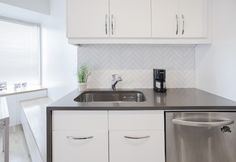 Add color to your white kitchen by include a contrasting color like Concrete. Simple to clean countertops, look good with everything, what more can you ask for?