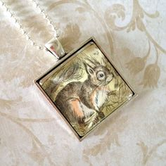 Squirrel!  One-of-a-kind necklace made from a vintage postage stamp (Czechoslovakia, 1960s); by CrowBiz