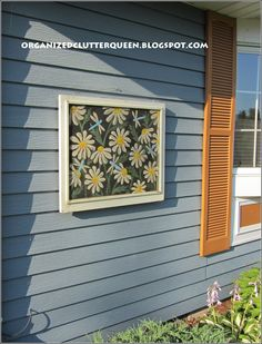 Beautiful daisies and dragonflies painted on an old window screen.