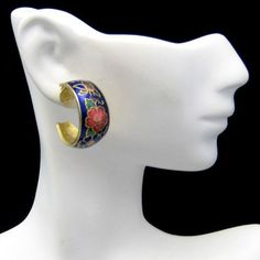 FASHION FACT: Did you know that Cloisonné is an ancient technique for decorating metalwork objects? In recent centuries the process used vitreous enamel, but in older periods the process used inlays of cut gemstones, glass, and other materials. These vintage Cloisonné earrings have lovely pink flowers on a blue background. Vintage Goldtone Post Earrings Goldtone Blue Cloisonne Hoops Pink Flowers, $39.95 from http://stores.ebay.com/My-Classic-Jewelry-Shop :)