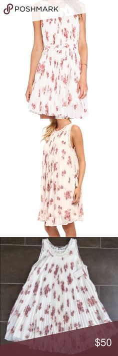 """NWT Free People Gardenia Pleated Lace Tent Dress Brand new with tags Free People gardenia pleated lace tent dress. Super pretty, feminine delicate lace dress that is perfect for spring! Pleated, lace trim and sides. Ties that you can either tie on the sides or around as seen in model pic. Size Small. Total length is 34"""". Brand new with tags! Free People Dresses"""
