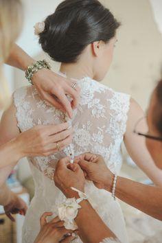 Getting the bride ready: http://www.stylemepretty.com/little-black-book-blog/2014/12/08/elegant-pozzo-della-chiana-wedding/   Photography: L&V - http://landvphotography.it/