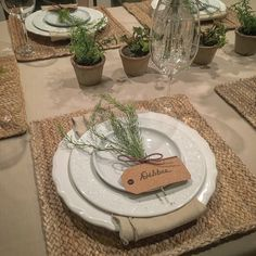 Textured all white dishes with burlap and farmhouse charm.
