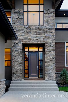 Veranda Interiors:: stone, incorporated side lights with transom