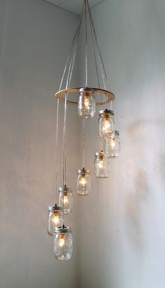 <3 Mason Jar Chandelier/Spiral Carousel Swag Lamp. $200.00 on Etsy.