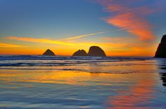 With Labor Day being the unofficial end of summer, a stunning sunset with a very colorful reflection was offered up to send off the season at one of my favorite spots along the Oregon coast. Three Arch Rocks, in the little beachside community of Oceanside, is a national wildlife refuge, a haven for birds and other sea life. In fact, a number of gray whales were feeding and playing right near the rocks for most of the afternoon!