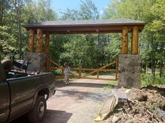 Driveway Entrance Gates | Grand Driveway Rustic Gate Entrance requiring custom hardware