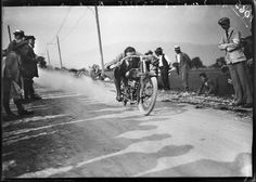 Jules Decrauzat: The First Swiss Sports Photographer Motorcyclist Robert dashes past a kilometer post with his 500ccm machine by the Swiss producer Motosacoche SA Dufaux