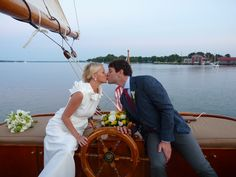 Kissing at the wheel, oh my! for nautical romance, relaxation, and an authentic experience aboard the yacht Sail Selina II, St Michaels MD plan an intimate elopement or small wedding