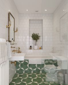 Adore these patterned green tiles in this small bathroom. They are so striking and work so well with the gold taps, mirror and fittings.
