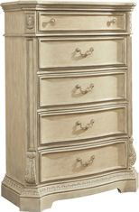 Ashley Ortanique Chest - The exquisite Old World beauty of the Ortanique bedroom collection comes to life with the opulent white finish flowing smoothly over the elaborately moulded ornamentation all of which is perfectly complemented by the natural marble parquetry tops of the dresser and night stand create an elegant atmosphere for any bedroom decor.
