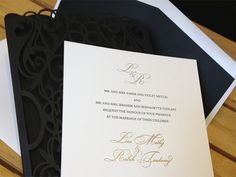 Custom black chantilly lace laser cut invitation pockets or sleeves as they're called in the wedding industry. We worked with Duly Noted Stationary in Halifax, Canada to design and produce these lovely invitation holders. The invitations and reply cards were printed with letterpress and gold foil for a polished classical look. The sleeves were made with a convenient pocket in the back to hold the reply cards.