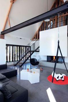 Une cheminée à double foyer  Photo : Fabienne Delafraye