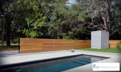 A beautiful modern horizontal board fence around a pool. #fencing
