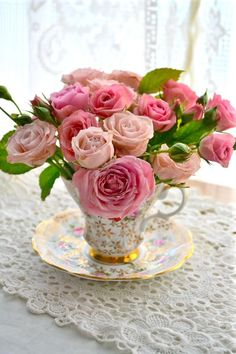 Flowers in teacups- so cute. Note to self- remember I have a set of 8 small cups and saucers packed away that were given to me- check size
