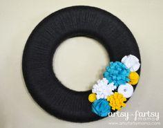 DIY Yarn Wreath at artsyfartsymama.com #wreath #yarn