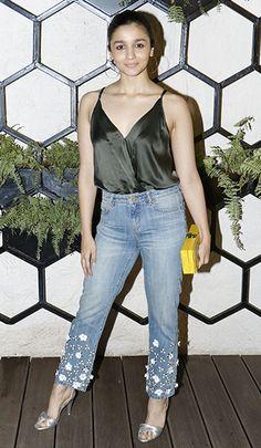 Alia Bhatt in a Michelle Mason top, Michael Kors jeans, Edie Parker clutch, and Zara sandals