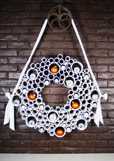 The PVC makes this a little intense, but would love to try the #wreath concept using paper!