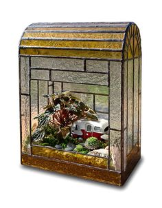Arched Terrarium.  I love the little camper.  Wouldn't this be cute as a fairy garden?