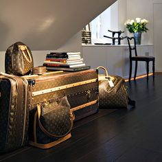 Louis Vuitton Luggage as side table. love