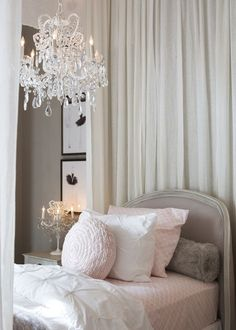 Gorgeous delicate, nude & pink tones here teamed with an elaborate chandelier.