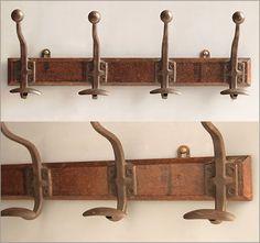 Row of 4 Victorian metal coathooks on oak backing