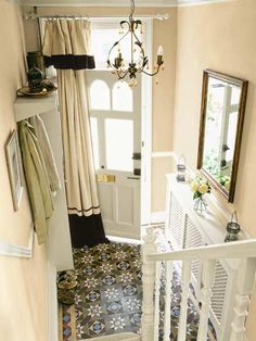 """Here's a post from Simpson Door (re-posting from This Old House): """"Idea of the Day: Would you dare to put a """"window treatment"""" on your front door? Block drafts and highlight the entry with a curtain as shown. See more on this and 49 other money-saving DIY ideashttp://www.thisoldhouse.com/toh/photos/0,,20639152_21227186,00.html"""""""