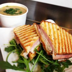 Soup and sandwich combo: roast turkey and/or black forest ham panini with chipotle mustard and cheddar, and winter vegetable soup.  http://www.bakeshopoakland.com/