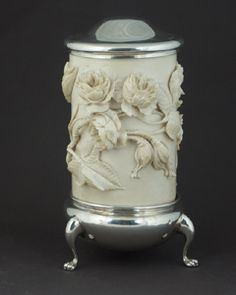 Silver Mounted Ivory Biscuit Barrel - A very rare and unusual carved ivory biscuit barrel with sterling silver mounts. The very fine mono bloc carving depicting in high relief roses covering the ivory the silver base and lid of fine quality and good gauge. makers mark J H P in separate shields for John Henry Potter Sheffield hallmark for 1913