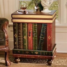 Design Toscano SK3345 The Lord Byron Wooden Entry Table  This trompe l'oeil side table fools the eye with its intricately hand-painted volumes that create