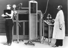 Vintage Chest X-ray Machine 1910. I love how they held the IR and hugged it...we still have patients hug the bucky :)