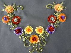 Ribbon embroidered vine and leaves with sequin flowers.