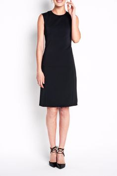 Our newest sheath dress is a must-have staple for any woman's wardrobe. With a classic crew neck and sophisticated knee-skimming length, this elevated, easy-to-wear dress pairs well with any blazer. The slim silhouette is cut from stretch fabric and features figure-flattering angled seams   Bedford Dress by Of Mercer. Clothing - Dresses - LBD Clothing - Dresses - Knee Clothing - Dresses - Work New York City