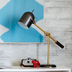 """Kenneth Table Lamp from west elm.  Antique Bronze-finished base with Antique Brass-finished accents. 24""""w x 7""""d x 24""""h."""