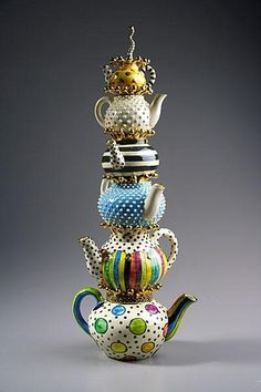 High tea.-Love it: I created something similar with teapots and one with teacups in my white garden.