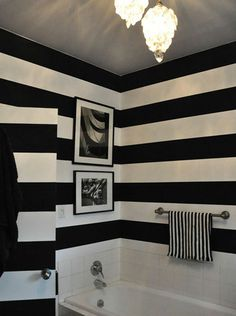 Black and white stripes on bathroom wall